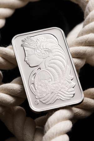 Platinum ingot on white rope