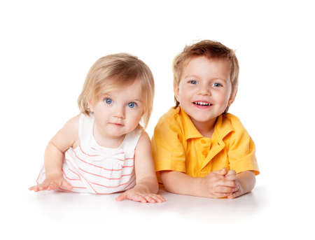 Smiling young brother and sister Isolated photo