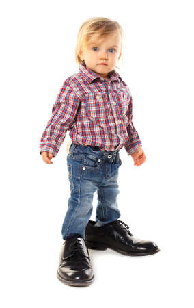 Little baby in father s shoes Stock Photo