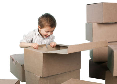 little boy looks in a box Stock Photo