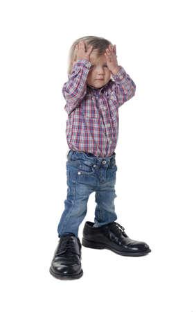 little girl has big shoes