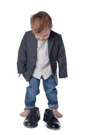Little boy on the big shoes photo