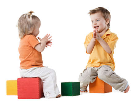 little kids plays with cubes Stock Photo