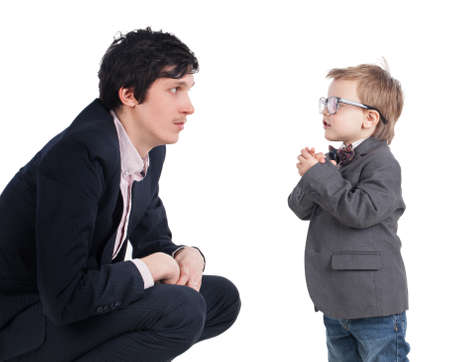 Man and little boy shake hands isolated on the white photo