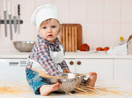 Portrait of a little chef hat and apron