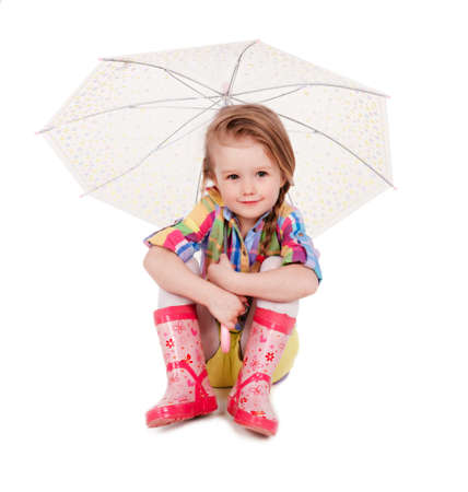 The little girl with an umbrella and in rubber boots  Isolated on a white background Stock Photo