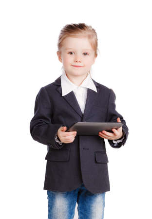 Little business girl with a tablet photo