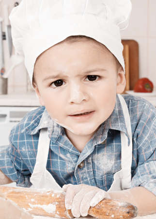 Portrait of a little chef hat and apron photo