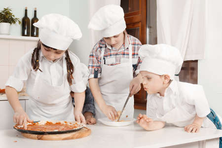 Children in clothes cooks photo