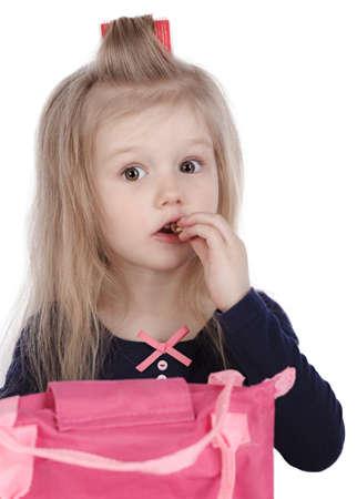 little girl eats candy photo