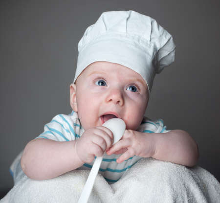 ittle: ittle boy in a chef hat Stock Photo