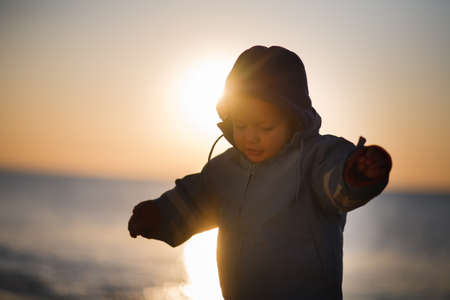 boy on a field in sunset Stock Photo