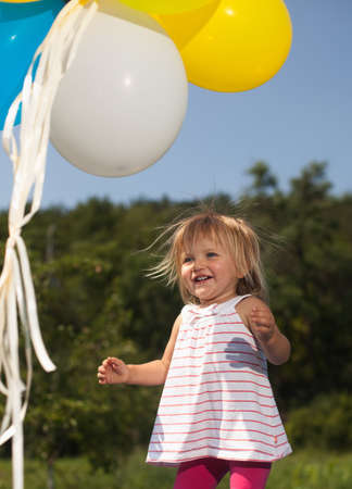 mom girl plays with balloons photo