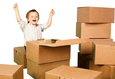 chłopięctwo: little boy found in a box gift. Isolation on white background Zdjęcie Seryjne