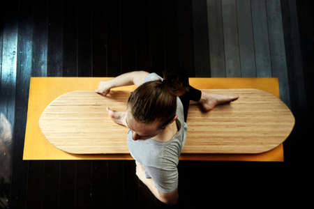 young man practicing yoga on a yoga board. Banco de Imagens