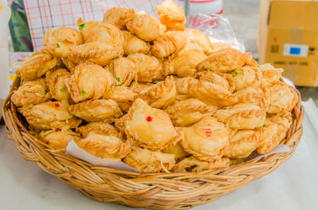 Flaky curry puffs filled with meat, potatoes, and curry  photo