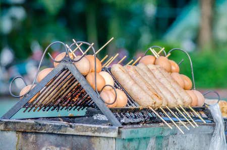 Hot Dogs and Eggs on Barbecue Grill photo