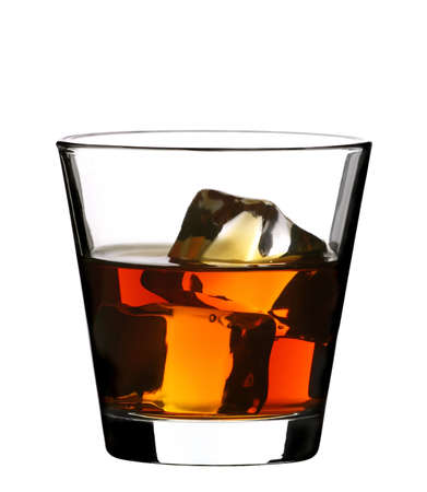 distilled water: glass of whiskey with ice cubes on white background