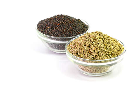 indian mustard: Indian Brown Mustard Seeds and cumin seeds isolated on white background
