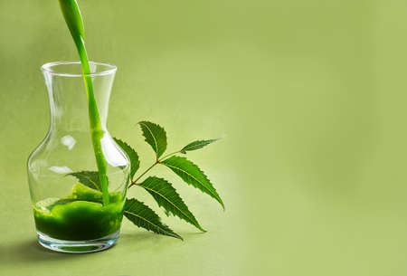 Medicinal Neem juice and leaves Stock Photo