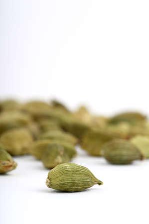 Cardamom pods on white background Stock Photo