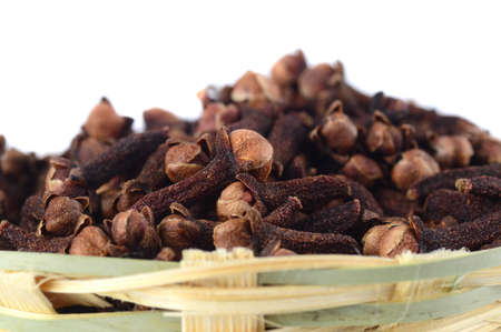 Cloves (spice) in bamboo basket isolated on white background