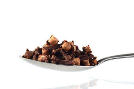 clove in spoon isolated on a white background Stock Photo