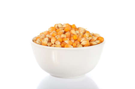 processed grains: Dried corn in bowl Stock Photo
