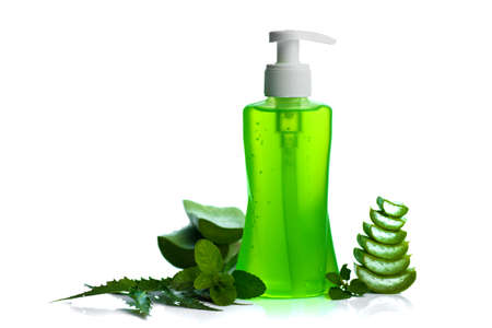 Bottle of liquid soap or cream or face wash dispensers with aloe vera, neem and basil leaf isolated on white background. 스톡 콘텐츠