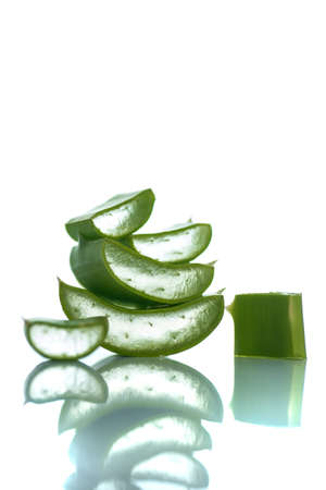 Slices of Aloe Vera leaves on a white background. Aloe Vera is a very useful herbal medicine for skincare and hair care. 스톡 콘텐츠