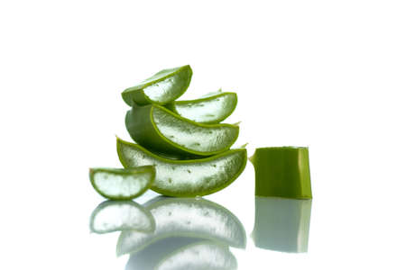 Slices of Aloe Vera leaves on a white background. Aloe Vera is a very useful herbal medicine for skincare and hair care. Фото со стока