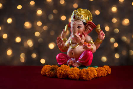 Hindu God Ganesha on Blured bokeh background, Ganesha Idol. Stockfoto