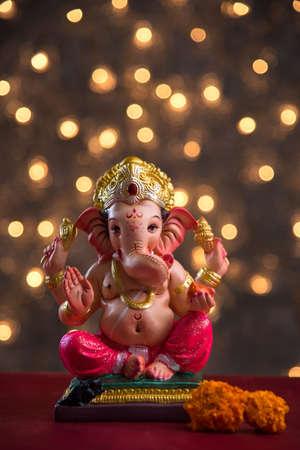 Hindu God Ganesha on Blured bokeh background, Ganesha Idol.