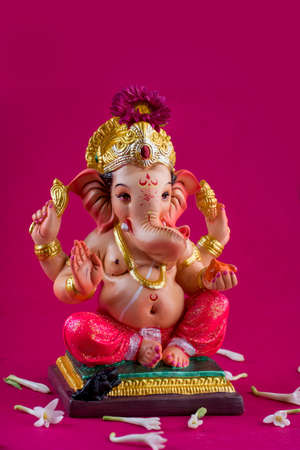 Hindu God Ganesha. Ganesha Idol on pink background. Imagens