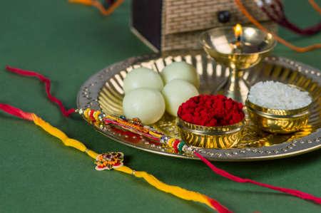Indian Festival: Raksha Bandhan or Rakhi background with an elegant Rakhi and diya