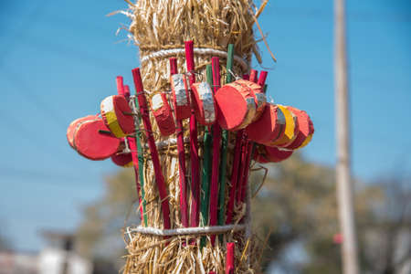 AMRAVATI, MAHARASHTRA, INDIA, JANUARY - 26, 2018: Unidentified street seller selling colorful handmade traditional baby rattle (mini drum) toy. Rural India