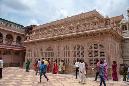 SHEGAON, MAHARASHTRA, INDIA, 10 JULY 2017 : Unidentified people visit and worshiping at Shri Saint Gajanan Maharaj Sansthan Temple. This temple and Anand Sagar is tourist attraction place of Shegaon Editorial