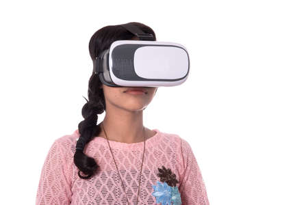 Indian young girl looking though VR device, 3D Virtual Reality Glasses headset, Girl with Modern imaging Future technology. Banco de Imagens