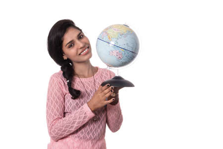 Beautiful Girl holding a world globe isolated on a white background