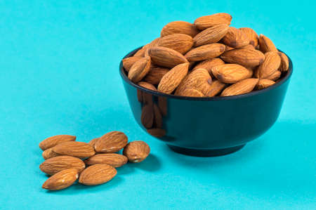 Close-up of Almonds on blue background
