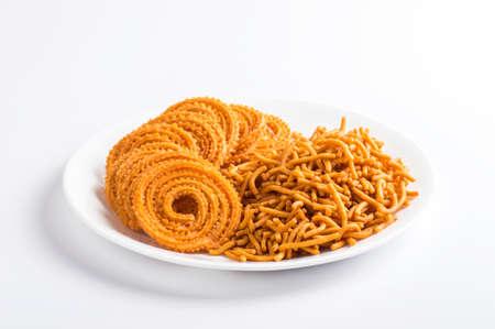 Indian Snack : Besan (Gram flour) Sev and chakli, chakali or Murukku. Stock Photo