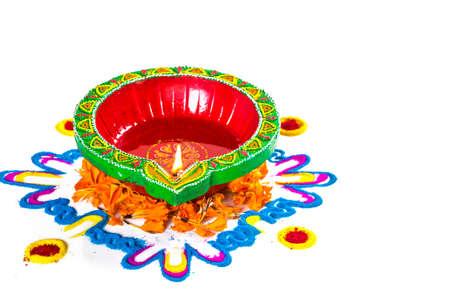 Clay diya lamp lit during diwali festival. Clay Diya on Rangoli. Happy Diwali Greetings Card Design, Indian Hindu Festival of Lights called Diwali.