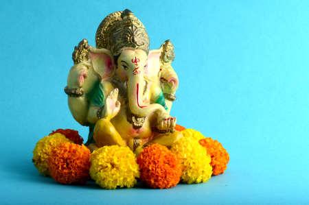 Hindu God Ganesha. Ganesha Idol on Blue Background Stock Photo