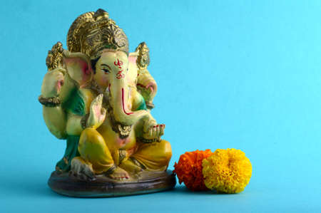 Hindu God Ganesha. Ganesha Idol on Blue Background Imagens