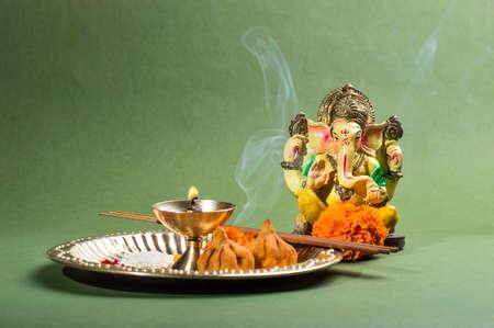 Hindu God Ganesha. Statue of Lord Ganesha. Pooja (Worship) arrangement.