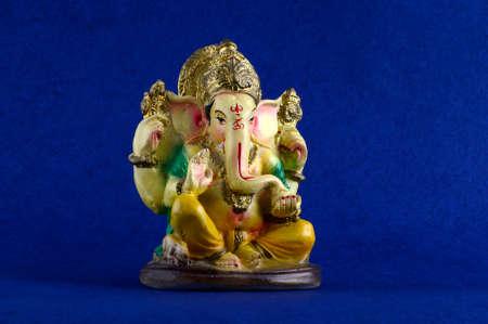 Hindu God Ganesha. Ganesha Idol on Blue Background