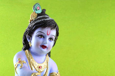 Hindu God Krishna on green background