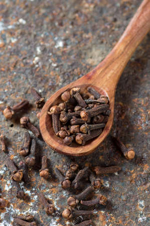 Cloves on a textured background. Spices, Food and cuisine ingredients.