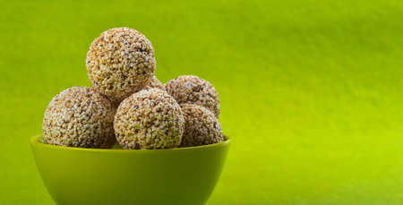Amaranth or Rajgira laddu, Cholai ke laddo in green Bowl on green background