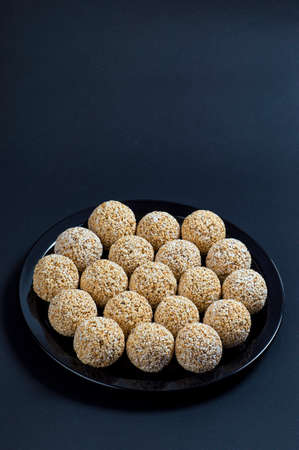 Amaranth ladoo or Rajgira laddu or Cholai ke laddo in black plate on black background.